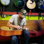james-gee-signing-the-give-away-guitar-2