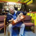 steve-shirey-signing-the-give-away-guitar-2
